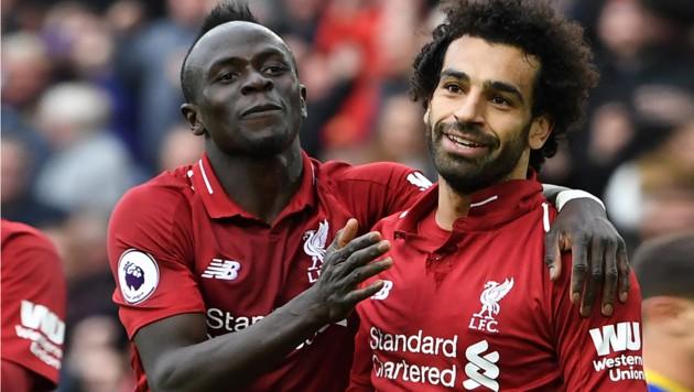 "Die ""Reds""-Offensivstars Sadio Mané und Mo Salah (Bild: AFP)"