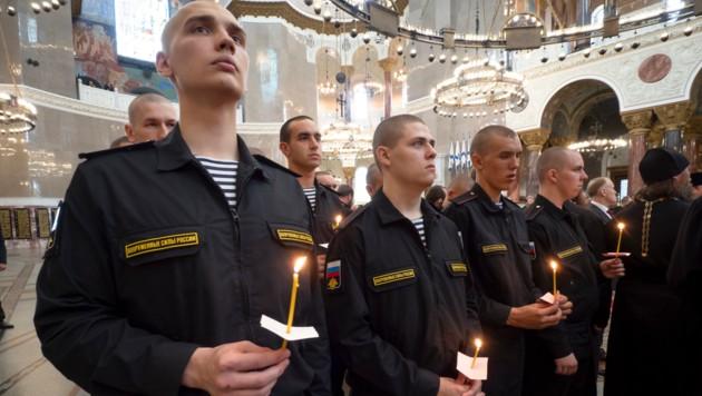 Trauergottesdienst für die verstorbenen Kameraden (Bild: AP)