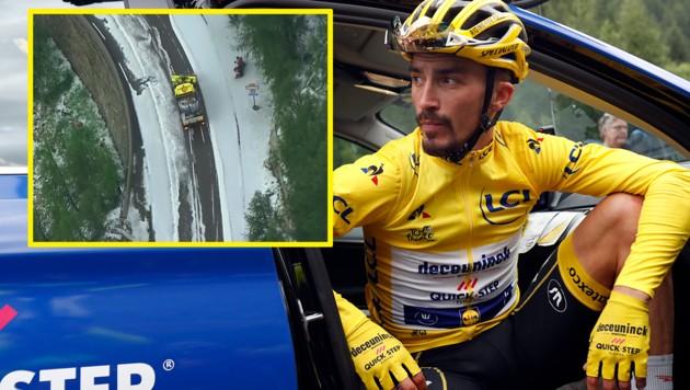 Der bisherige Gesamtführende Julian Alaphilippe kann's nicht fassen - ein Hagel-Unwetter hat die 19. Etappe der Tour de France vorzeitig beendet… (Bild: Associated Press, Twitter/Movistar_Team)