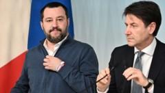 Italiens Regierungschef Giuseppe Conte (re.) und Lega-Chef Matteo Salvini (Bild: AFP)