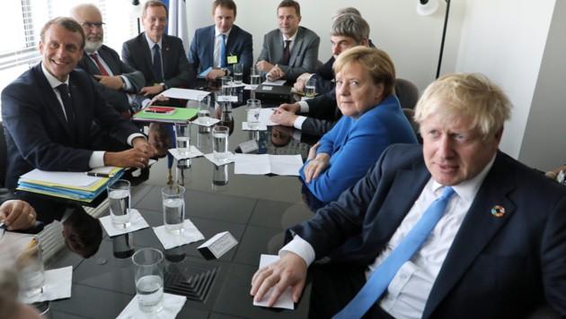 Hochrangiges Zusammentreffen im UNO-Hauptquartier: Macron (li.), Merkel und Johnson (Bild: APA/AFP/LUDOVIC MARIN)