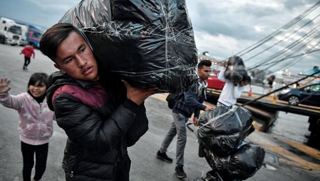 Ankommende Migranten (Bild: APA/AFP/LOUISA GOULIAMAKI)