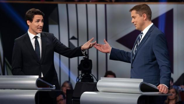 Kanadas Ministerpräsident Justin Trudeau und sein konservativer Herausforderer Andrew Scheer (Bild: AFP)