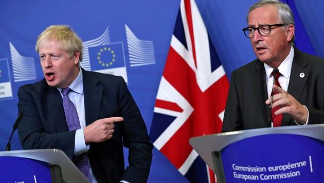 Der britische Premier Boris Johnson (li.), EU-Kommissionspräsident Jean-Claude Juncker (Bild: ASSOCIATED PRESS)