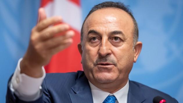 Der türkische Außenminister Mevlüt Cavusoglu (Bild: APA/AFP/Fabrice Coffrini)