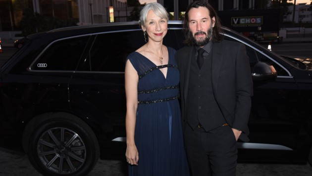 Alexandra Grant und Keanu Reeves (Bild: APA/AFP/Presley Ann/Getty Images for Audi)