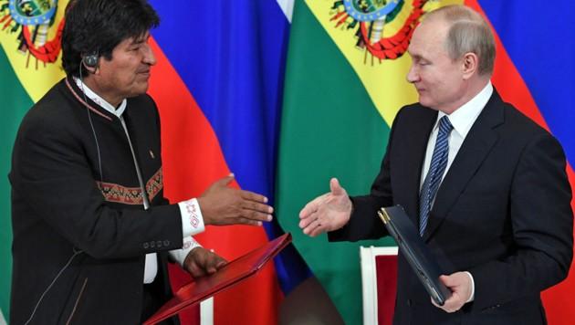 Jahrelange Männerfreundschaft: Morales im vergangenen Juli auf Moskau-Besuch bei Kreml-Chef Wladimir Putin (Bild: APA/AFP/)