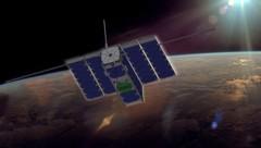 Künstlerische Illustration: Der Nanosatellit kreist in einer Höhe von 515 Kilometern um die Erde. (Bild: ESA)