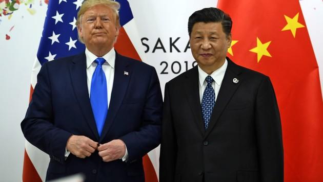Trump und sein chinesisches Gegenüber Xi Jinping (Bild: APA/AFP/BRENDAN SMIALOWSKI)