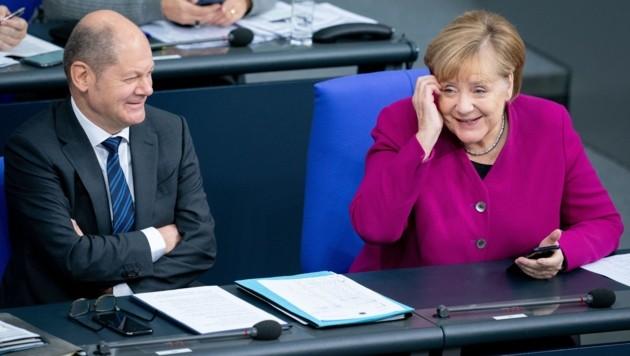 Der deutsche Finanzminster Olaf Scholz (SPD) und Bundeskanzlerin Angela Merkel (CDU) (Bild: APA/dpa/Kay Nietfeld)