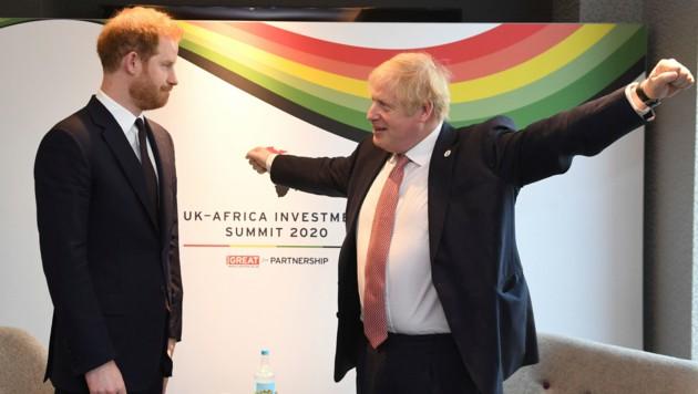 Prinz Harry und Boris Johnson (Bild: AP)
