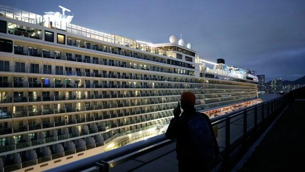 """Ein Passagier an Bord der """"World Dream"""" (Bild: Associated Press)"""