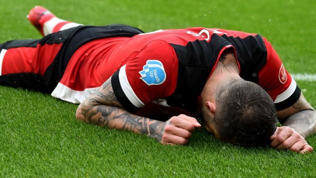 Nein, Southamptons Danny Ings geht's gut, er ist am Leben – aber die Frage, ob ein zu früher Liga-Neustart nicht vielleicht doch Leben kosten könnte, sorgt bei einigen Premier-League-Klubs für Besorgnis ... (Bild: AFP)