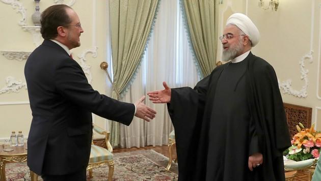 Schallenberg und der iranische Präsident Hassan Rouhani (Bild: AFP)