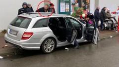 Laut deutschen Medien zeigt das Foto die Festnahme des Fahrers, der das Auto in die Menschenmenge gesteuert haben soll. (Bild: APA/AFP/Elmar SCHULTEN)