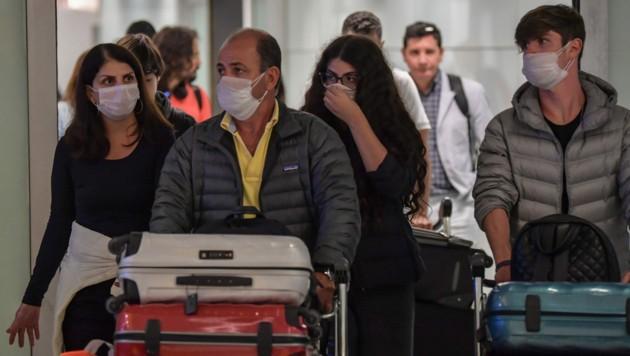 Laut Airlines erscheinen bis zur Hälfte der Reisenden derzeit nicht zu ihren Flügen und lassen ihre Tickets wegen der Corona-Epidemie verfallen. (Bild: AFP)