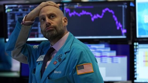 Am Montag setzten die New Yorker Aktienbörse an der Wall Street kurzzeitig den Handel aus. (Bild: AFP)