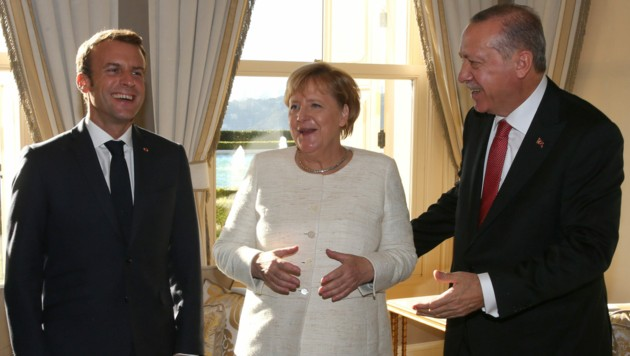 Emmanuel Macron, Angela Merkel und Recep Tayyip Erdogan (v.l.) (Bild: AFP)