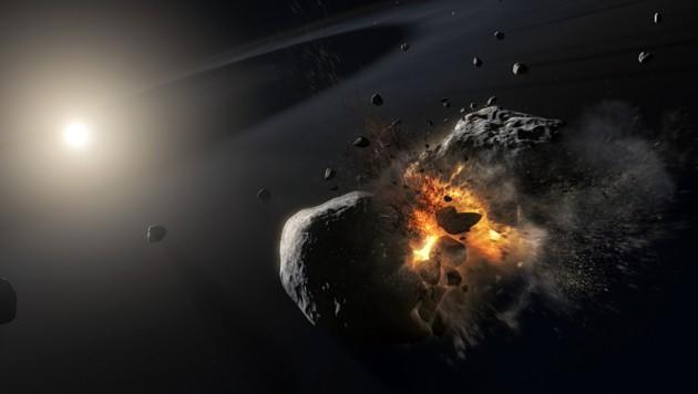Künstlerische Illustration: So stellen sich die Forscher die Kollision der zwei eisigen Himmelskörper vor. (Bild: ESA/NASA, M. Kornmesser)