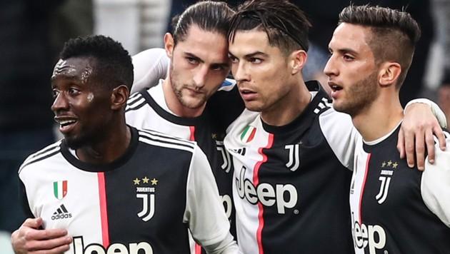 Blaise Matuidi (li.) mit seinen Juventus-Teamkollegen (Bild: AFP)