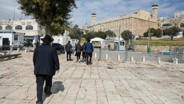 Jüdische Gläubige auf dem Weg zu den Patriarchengräbern in Hebron (Bild: APA/AFP/HAZEM BADER)