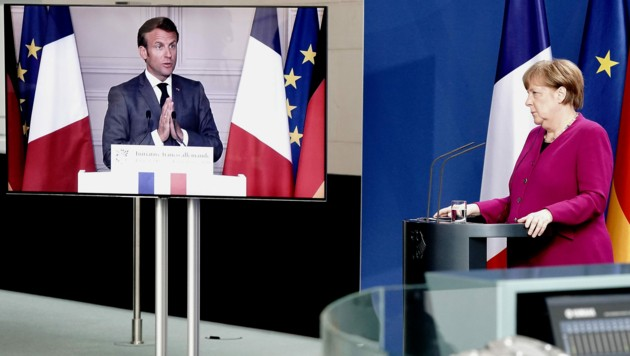 Die gemeinsame Pressekonferenz fand über Videotelefonie statt. (Bild: APA/AFP/POOL/Kay Nietfeld)