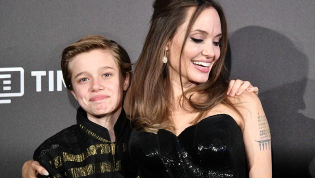 Angelina Jolie mit ihrer Tochter Shiloh (Bild: APA / Tiziana FABI / AFP)