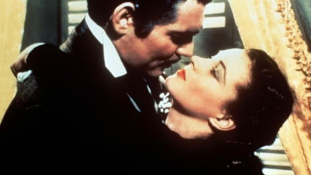 """Scarlett O'Hara (Vivien Leigh) und Rhett Butler (Clark Gable) schrieben mit """"Vom Winde verweht"""" 1939 Filmgeschichte. (Bild: dpa)"""