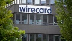 Der Schriftzug von Wirecard ist an der Firmenzentrale des Zahlungsdienstleisters zu sehen. (Bild: APA/dpa/Sven Hoppe)