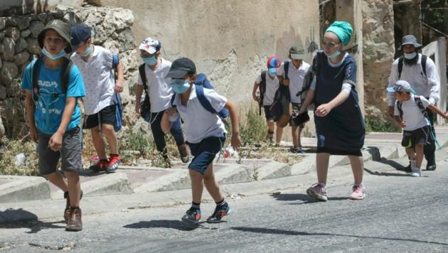 Israelische Siedler in der palästinensischen Stadt Hebron im besetzten Westjordanland.