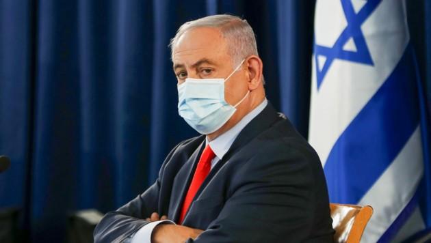 """Israels Premier Benjamin Netanyahu will die Wirtschaft unter anderem mit einer Einmalzahlung an alle Israelis """"wieder in Gang bringen"""". (Bild: APA/AFP/POOL/RONEN ZVULUN)"""