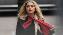 """Schauspielerin Amber Heard bei ihrer Ankunft zur Gerichtsverhandlung am 16. August 2020, dem achten Tage des Prozesses ihres Ex-Mannes Johnny Depp gegen die britische Zeitung """"The Sun"""". (Bild: APA/ Photo by JUSTIN TALLIS / AFP)"""