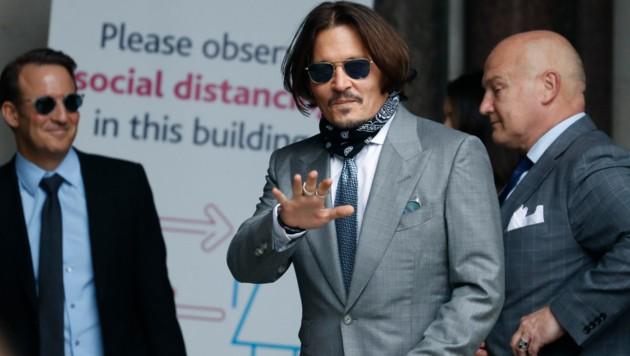 """Johnny Depp am 16. Juli 2020 auf dem Weg in den Gerichtssaal. Er hat die britische Zeitung """"The Sun"""" geklagt."""