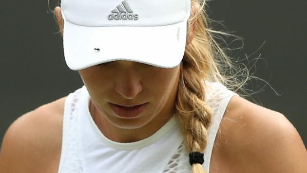Die Dänin Caroline Wozniacki kämpfte 2018 in Wimbledon nicht nur gegen ihre Tennis-Gegnerin, sondern auch gegen die fliegenden Insekten.