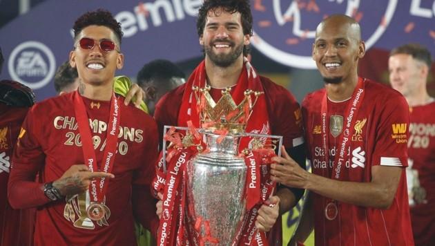 Roberto Firmino, Alisson Becker und Fabinho (von li. nach re.) (Bild: AFP)