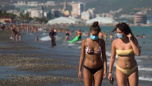 Touristen in Malaga (Bild: AFP)