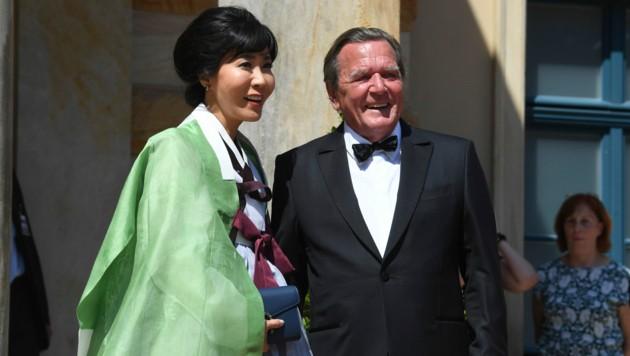 Gerhard Schröder mit seiner Frau Soyeon Schröder-Kim (Bild: APA/AFP)
