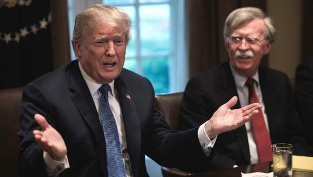 Von 2018 bis 2019 war John Bolton (r.) der nationale Sicherheitsberater von US-Präsident Donald Trump. (Bild: AFP)