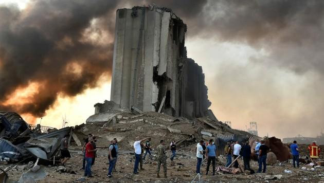 Ein zerstörter Getreidespeicher in der Nähe des Explosionsortes im Hafenviertel (Bild: APA/AFP/STR)