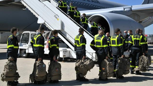 Französische Hilfe ist ebenfalls schon unterwegs. (Bild: APA/AFP/POOL/Bertrand GUAY)