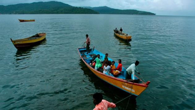 Fischer kehren nach Port Blair zurück, dem Hauptort der Andamanen. Schon zehn Angehörige der Groß-Adamaner wurden positiv auf das Coronavirus getestet.