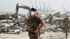 Sicherheitskräfte haben unweit des Hafens erneut eine größere Menge Ammoniumnitrat gefunden. (Bild: AP/Gonzalo Fuentes)