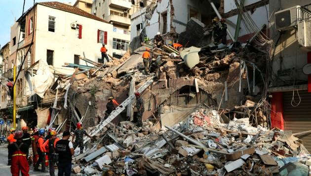 """Unter diesem Gebäude wurden die """"Lebenszeichen"""" entdeckt. (Bild: AP)"""