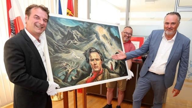 Nahmen das Gemälde in Empfang: Landeschef Hans Peter Doskozil (re.) und Museumsdirektor Gert Polster. (Bild: Reinhard Judt)