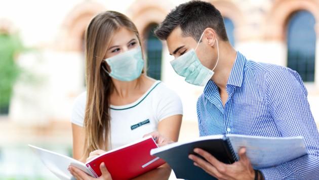 Ob die Studenten beim Start der neuen TU in OÖ noch Masken brauchen werden... (Bild: Minerva Studio/stock.adobe.com)