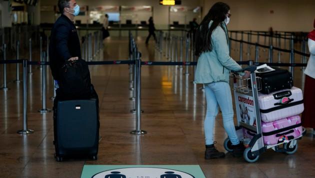 Passagiere am Brüsseler Flughafen (Bild: AFP)