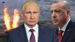 Kremlchef Wladimir Putin und der türkische Präsident Recep Tayyip Erdogan unterstützen im Konflikt um die Region Berg-Karabach unterschiedliche Kriegsparteien. (Bild: APA/Armenian Defence Ministry/AFP/Handout, AP, AFP, Krone KREATIV)