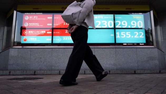 Auch in Japan verzeichneten die Finanzmärkte Verluste. (Bild: AP)