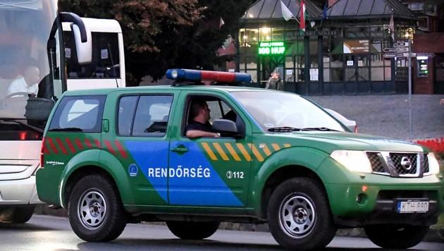 Polizeipatrouille in Budapest (Bild: APA/AFP/ATTILA KISBENEDEK)