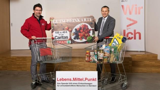 """""""Bereits 40 Euro reichen aus, um einer Familie in Not ein volles Einkaufswagerl zu schenken"""", erklären Caritas-Direktor Ernst Sandriesser und Spar-Geschäftsführer Paul Bacher die Aktion. (Bild: SPAR/gleissfoto)"""